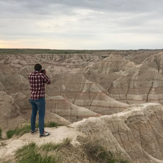 Man taking picture of south dakota sunset